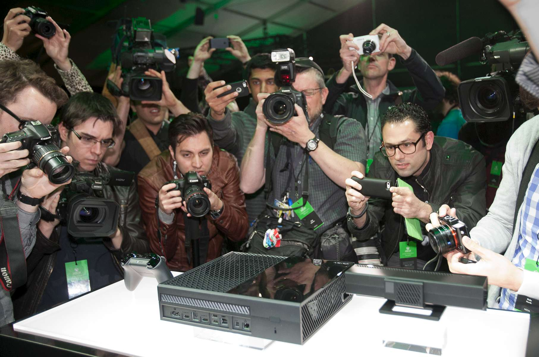 Photographers crowd around to get pictures of the new Xbox after its unveiling by Microsoft.