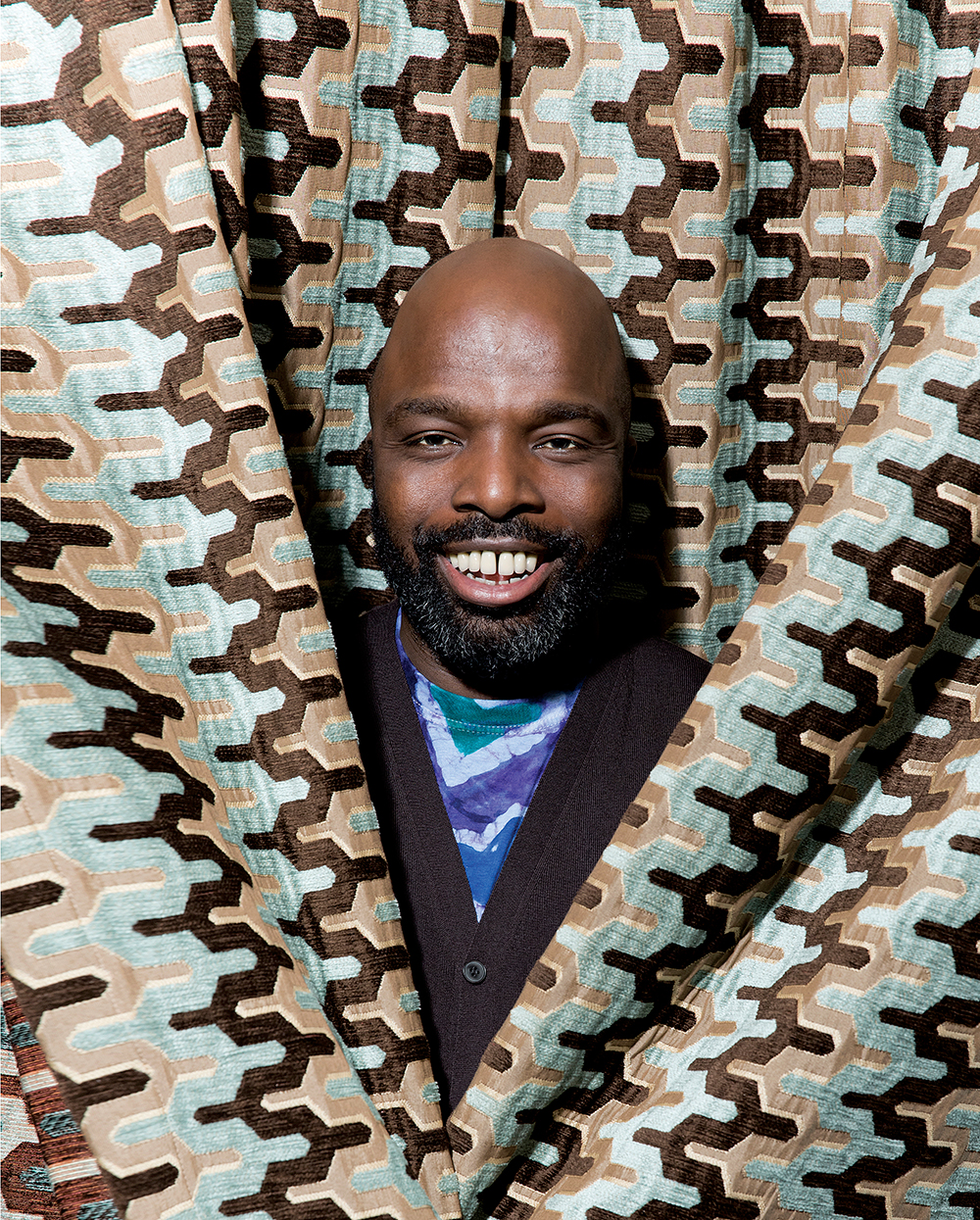 Duro Olowu is a Nigerian-born, London-based fashion designer. He is best known for his innovative combinations of patterns and textiles that draw inspiration from his international background. His empire waist patchwork {quote}Duro{quote} dress was named {quote}dress of the year{quote} by both American and British Vogue in 2005. Some of Olowu's notable clients include Michelle Obama, Solange Knowles, and Iris Apfel. In 2005 he won {quote}New Designer of the Year{quote} at the British Fashion awards, the first designer to win without ever showing a runway presentation.