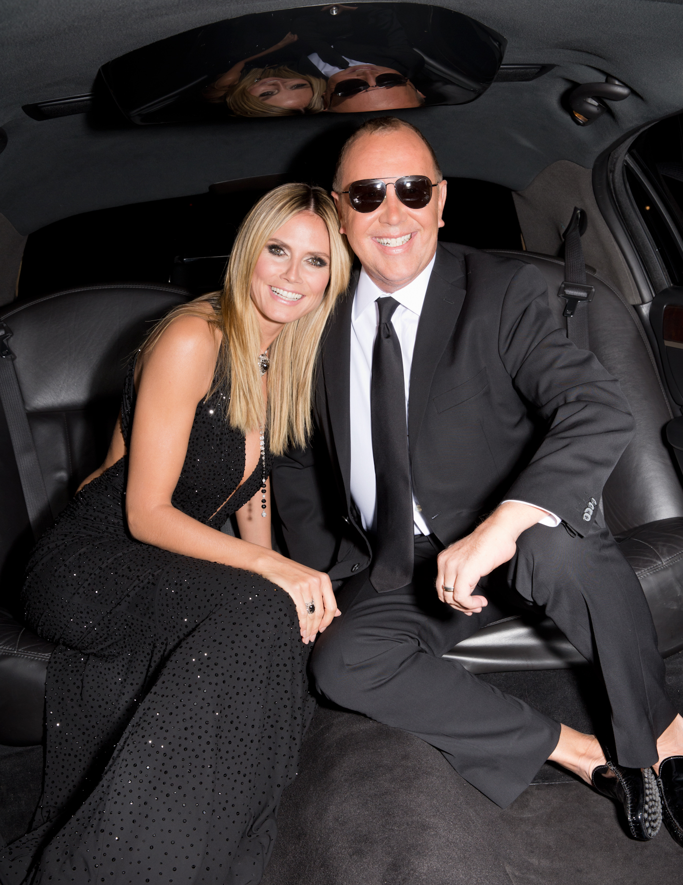 Heidi Klum and designer Michael Kors taking a ride in a limo
