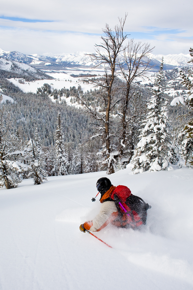 Christopher Cook drops a knee in some light January powder.