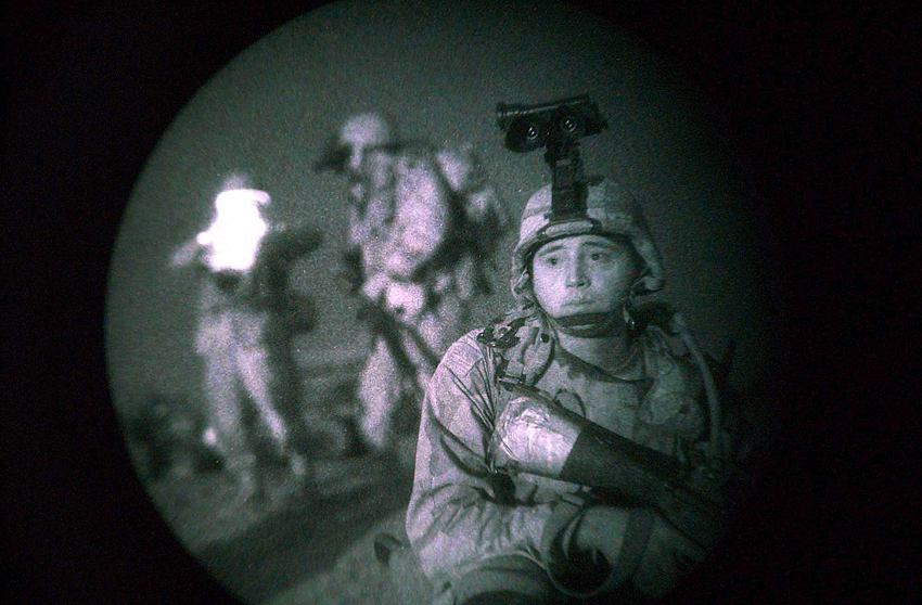 SPC Danny Lantagne with the 4th Platoon of the 119th Military Police Company is the point man for a dismounted night-time sweep in an area known for Iraqi insurgent activity, in the company's patrol area outside Baghdad. The Platoon conducts the sweep in complete darkness as is seen through NVGs (night vision googles) used by the soldiers.