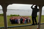 Photographer Denny Moers gathers the wedding party of Stephen Doody and Kristina Anes who marry at the Sullivan House on Block Island.