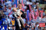 With his son, Jack, in hand, vice-presidential candidate John Edwards acknowledges a cheering crowd following his speech at the Democratic National Convention at the FleetCenter in Boston, Mass.