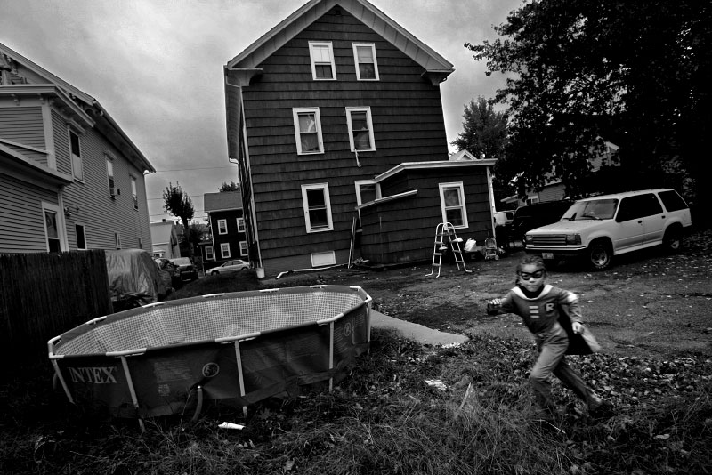 Latisha Silva and her three children - 9, 7 and 2 years old - must move from their apartment in Pawtucket, R.I., when their landlord is foreclosed upon. Through the ordeal of searching for a new home, Latisha tries to keep family routine intact – making sure the children get to after-school activities and sporting events. Seven-year-old Isaiah, who is autistic, models his superhero Halloween costume before a neighborhood party.