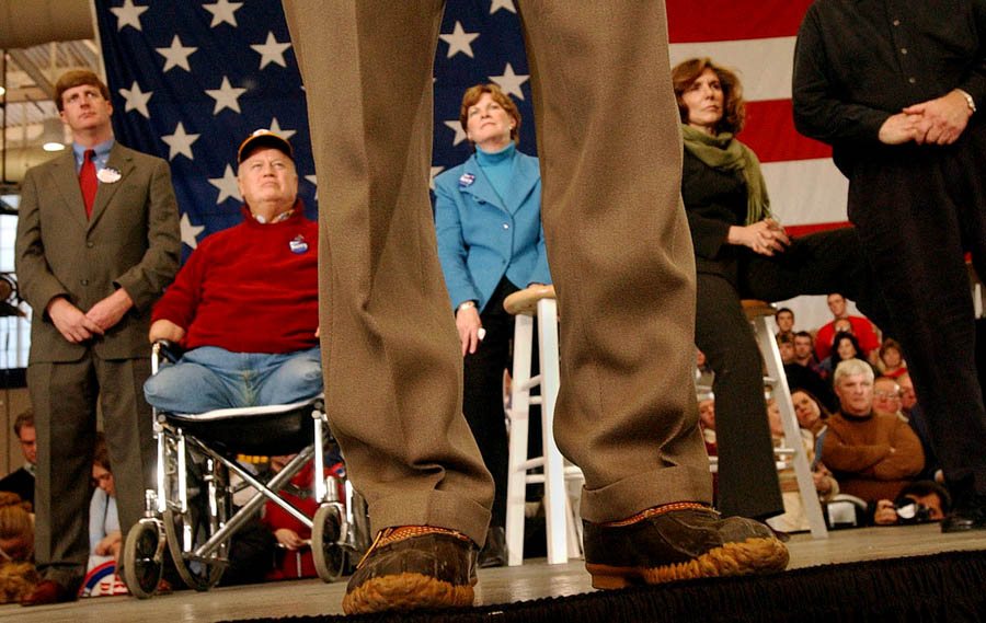 Flanked by Congressman Patrick Kennedy, left, Senator Max Cleland, Governor Jeanne Shaheen and wife Teresa Heinz, Democratic presidential candidate Senator John Kerry wears his signature duck boots while addressing a rally at Nashua High School in Nashua, New Hampshire.