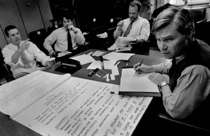 Attorney General Sheldon Whitehouse, right, prepares his case on behalf of the state's lead poisoned children against the manufacturers of lead paint pigment and their trade associations. Joining Whitehouse in the {quote}War Room{quote} are lawyers Jack McConnell, of Ness Motley, left, Christopher E. Hultquist, of Decof & Grimm and Bob McConnell of Ness Motley.