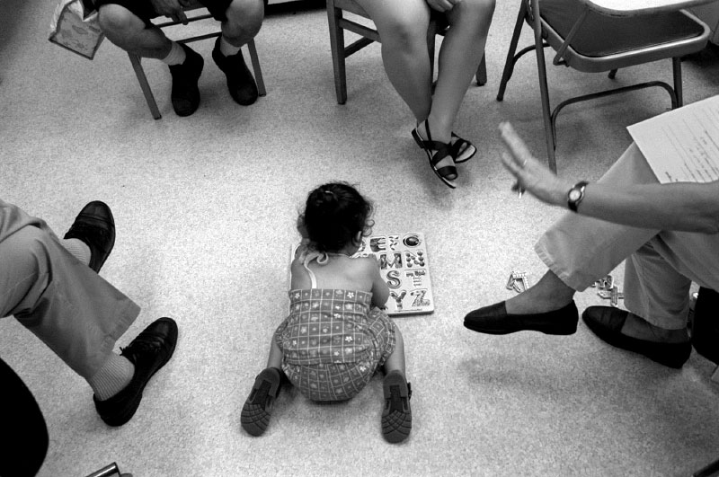 At lead clinic, developmental testing is conducted on a young lead poisoned girl to determine if early intervention is necessary. Often, young children who display developmental delays will be referred to Head Start.