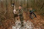 Ten-year-old Holden Reynolds plucks feathers at his North Kingstown home from a Canada goose he shot with the help of an adult family friend. This was the second goose for Reynolds, who has been hunting since he was seven. On the right is his brother, eight-year-old Hudson Reynolds.