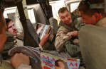 SGT Phillip Wagoner, left, SPC Richard Busa, SPC Randy LeBoeuf and SPC Nathaniel Deitch look at magazines during a visit to Forward Operating Base Summerall near Baiji, Iraq, where the detachment plans to move in the next week.