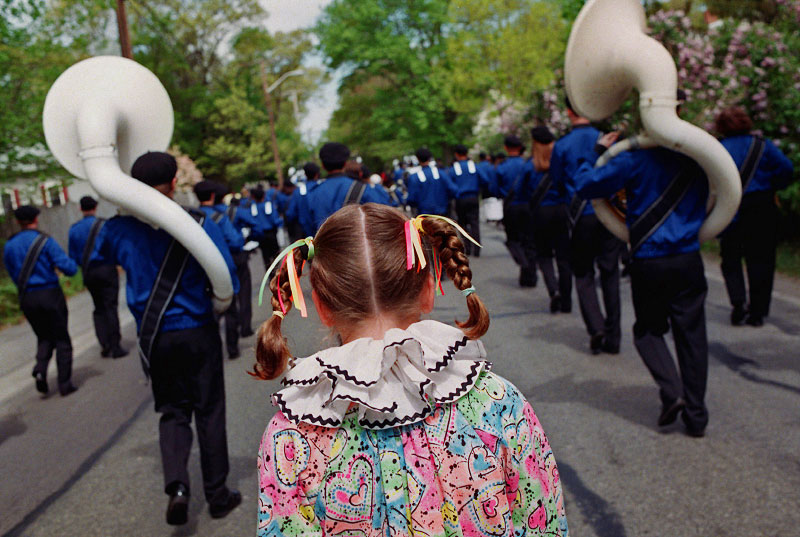 A young girl follows the band in the Seekonk, Mass. Memorial Day parade.