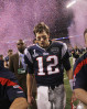 New England Patriots quarterback Tom Brady leaves the field at Lucas Oil Stadium in Indianapolis following his team's upset loss to the New York Giants in Super Bowl XLVI.