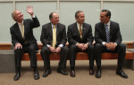 In a rare gathering of all four Rhode Island  gubernatorial candidates, now Governor Lincoln Chafee, left, acknowledges a friend during an event where they all sign a pledge to more than double the percentage of woman appointed to boards and commissions, as well as high-level staff and cabinet positions in their administration.