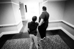 "Darell ""Squeaky"" Valentine, a multiple handicapped therapy and instructional teacher at Andrew Lewis Middle School, leads Tomas down a hallway at Hotel Roanoke.  Zina credits Squeaky for Tomas's progress over the last few years. Squeaky is the only male influence in Tomas's life, and he and Tomas have a very close relationship."