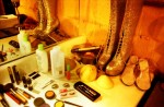 Fake breasts, razors, and duct tape mingle with makeup and gold rhinestone boots backstage.