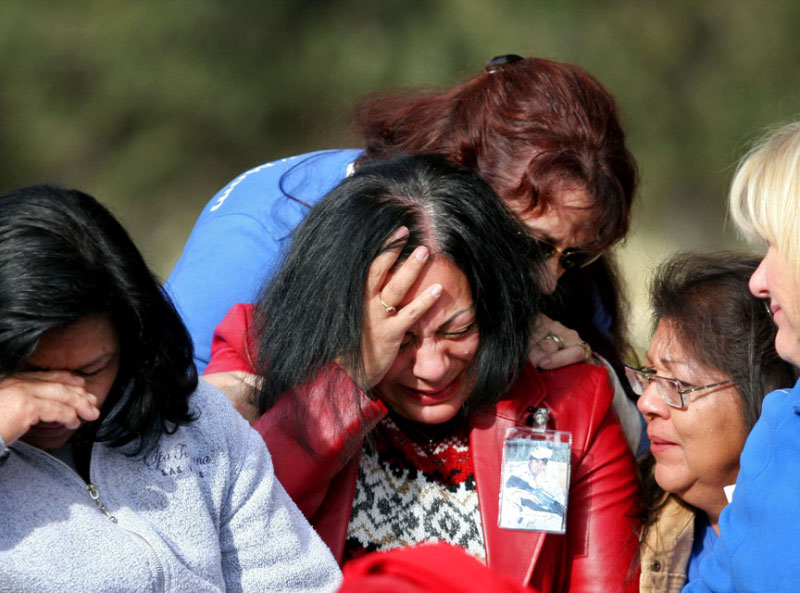 Marina Vance, center, is comforted by memebers of the Blue Star Mothers of Amecia during the Wreaths Across America ceremony at the Southern Nevada Veterans Memorial Cemetery Thursday, Dec. 14, 2006, in Boulder City. Vance lost her son Army Specialist  Ignacio Ramirez, 22, in Iraq this year. Today memorial wreaths were placed at over 270 state and national cemeteries and monuments to honor fallen heroes in all branches of the millitary.