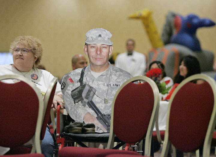 Patt Sprague, 62, sits with a cardboard cutout of her husband Richard while listening to Congressman John Porter's band {quote}Second Amendments{quote} during the Armed Forces Foundation's Operation Oasis concert and fair at the Venetian hotel-casino on behalf of Military Family Appreciation Day Sunday, Aug. 5, 2007. Richard Sprague is currently deployed in Iraq with the 593rd Medium Transportation Company with the Nevada Army National Guard.