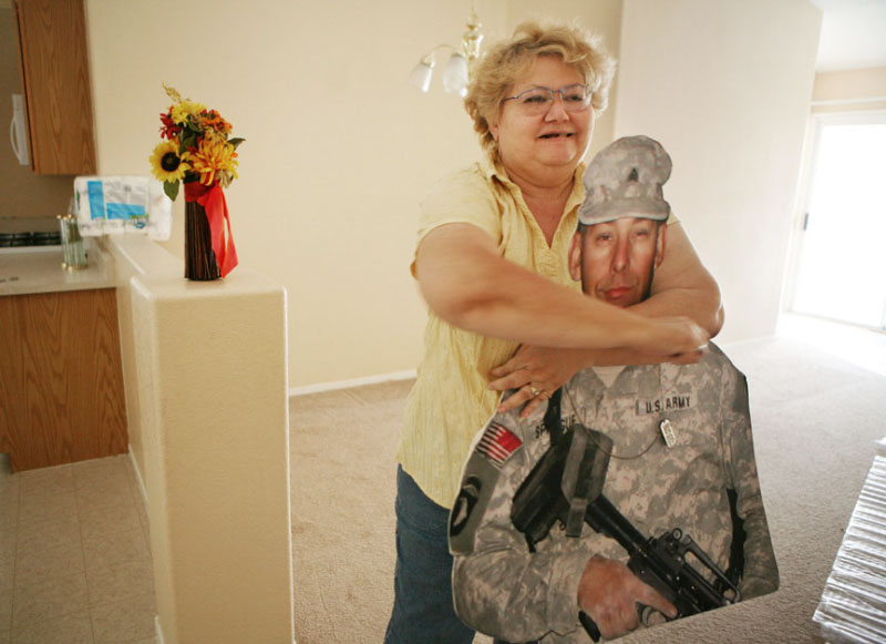 Patt  hugs the cutout on moving day Wednesday, Aug. 15, 2007 in North Las Vegas. {quote}Grandpa{quote} shows signs of wear from the grandchildren playing with it and from Patt's hugs
