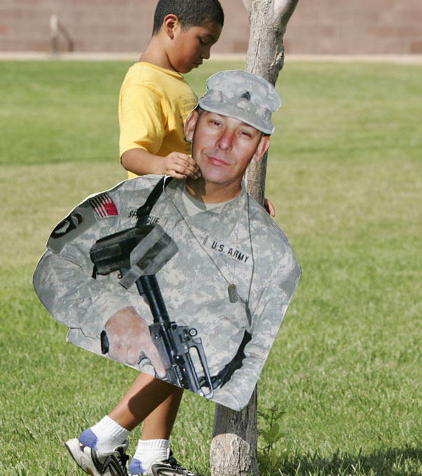 "Christian walks with ""Grandpa"" during a family picnic for family members of deployed and remote soldiers, which is sponsored by Airman and Family Readiness Center, at Nellis Air Force Base Sunday, Aug. 12, 2007."