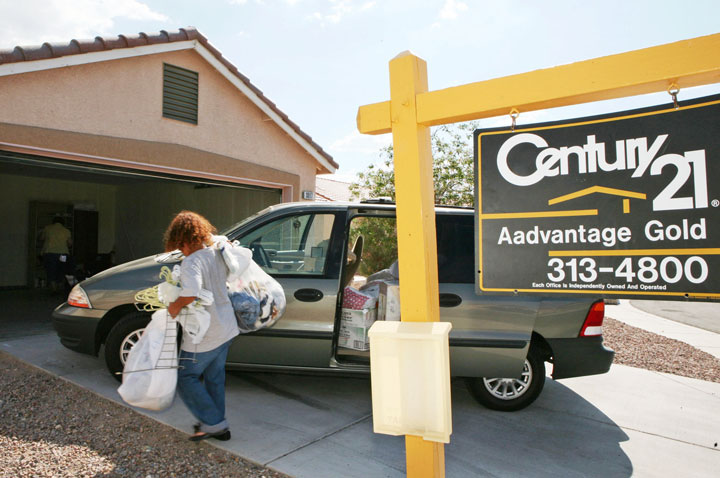 Mary Lopez, the mother of the Sprague's grandchildren, helps move into their new home Wednesday, Aug. 15, 2007 in North Las Vegas. Richard's deployment has helped the family save money in order to move from their cramped mobile home into a spacious and modern house.