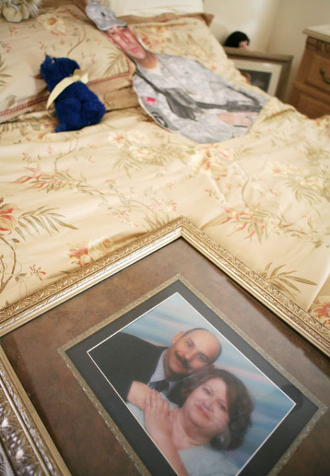 A photograph of Sgt. Richard Sprague and his wife Patt lays on the bed near a stuffed animal and cutout in the master bedroom Wednesday, Aug. 22, 2007.