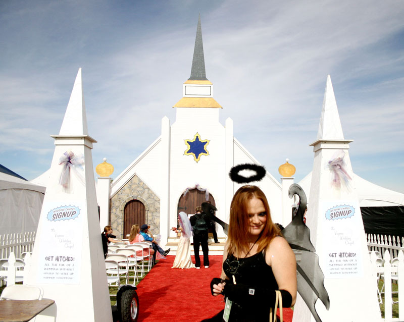 Sherrie Hannah persuades concert attendees to stop by the Vegoose Wedding Chapel to witness impromptu imitation weddings during the music festival that falls on Halloween weekend at Sam Boyd Stadium.