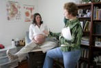Heather Mayer, 29, and Certified Professional Midwife Jill Colin joke during a check-up at Colin's North Las Vegas home office Friday, Jan. 21, 2005. Heather anxiously awaits the birth of her baby, which is now 9 days overdue, and asks what she can do naturally to progress labor.