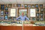 "Mordechai Yerushalmi stands by his ""famous wall"" at his business, The Jewelers of Las Vegas Wednesday, Nov. 2, 2011."