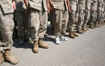 A pair of white Etnies shoes, worn by Lance Corporal Kevin Corr, can be seen among a row of regulation boots during a welcoming-home ceremony at Nellis Air Force Base in Las Vegas, Nevada. Corr accidentally packed his boots prior to returning home with the Marine Forces Rescue Unit, Detachment 2 Bravo Company 6th Motor Transport Battalion. The unit was stationed in Taqaddum, Iraq.
