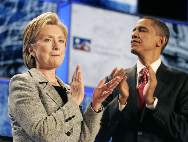 Democratic presidential hopefuls Sen. Hillary Rodham Clinton, D-N.Y. and Sen. Barack Obama, D-Ill. are shown at the start of the Democratic debate at the Cox Pavilion at the University of Nevada, Las Vegas Thursday, Nov. 15, 2007, in Las Vegas.