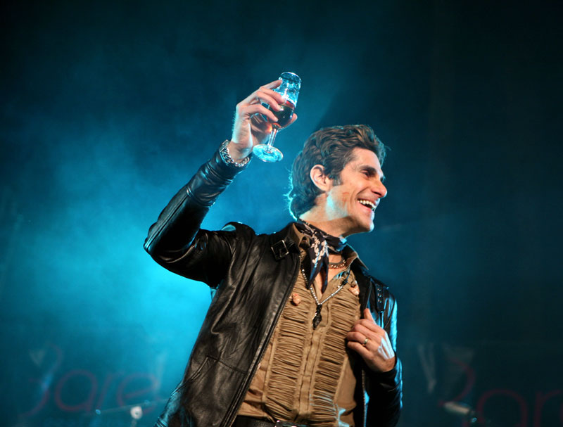 Perry Farrell, frontman of Jane's Addiction, raises his glass during a birthday party celebration at Bare pool Saturday, April 11, 2009.