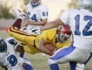 Del Sol's Bryan Grenier, center, busts through Basic defense during the first quarter of a game at Del Sol High School Friday, Oct. 5, 2007.