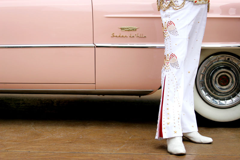 Eddie Powers, dressed as Elvis, stands near his 1956 pink Cadillac Sedan de Ville during the Cadillac Through the Years car show at The District at Green Valley Ranch Sunday, Feb. 11, 2007.