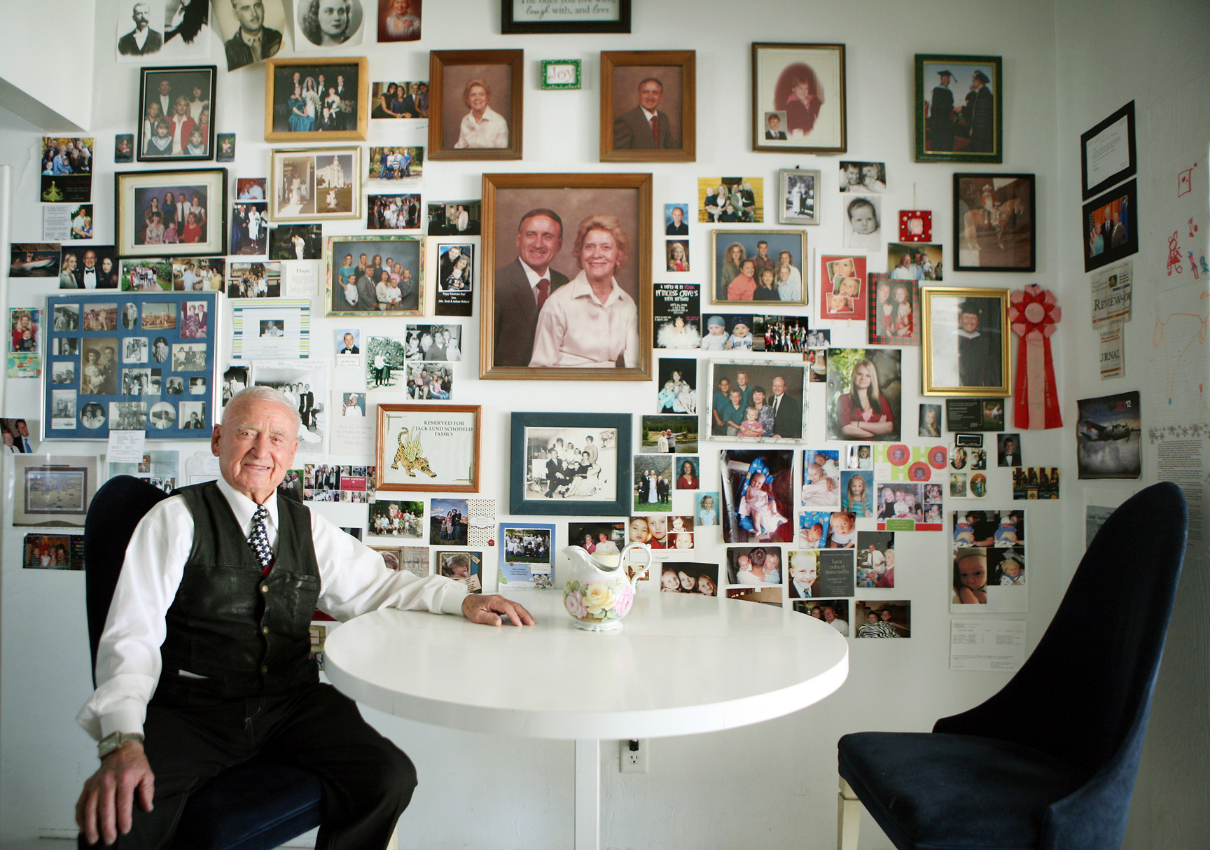 Dr. Jack Schofield, a member of the Nevada System of Higher Education Board of Regents, sits in front of a collage of family photographs in his kitchen Monday, March 11, 2013, in Las Vegas. Schofield, 90, who has six children and has been married to his wife Alene for 71 years, has an extensive list of accomplishments in Las Vegas and Nevada including a middle school named after him. The University of Utah is honoring Schofield with the College of Science Distinguished Alumni Award.
