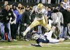 UCLA wide receiver Logan Paulsen jumps over BYU defender Ben Criddle after catching a pass late in the fourth quarter of the Las Vegas Bowlat Sam Boyd Stadium Saturday, Dec. 22, 2007. The Bruins drove into position for a 28-yard field-goal attempt by Kai Forbath, but the kick was blocked by the Cougars.