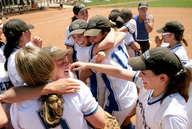 McQueen High School girls softball team celebrates their victory over Sierra Vista High School after winning the State Championship Saturday, May 21, 2005.