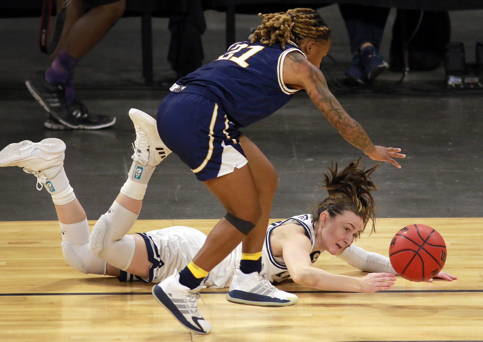 UC Davis' Mackenzie Trpcic (00) and UC Irvine's Haleigh Talbert (21) go after a loose ball during the first half of an NCAA college basketball game in the championship of the Big West Conference tournament.