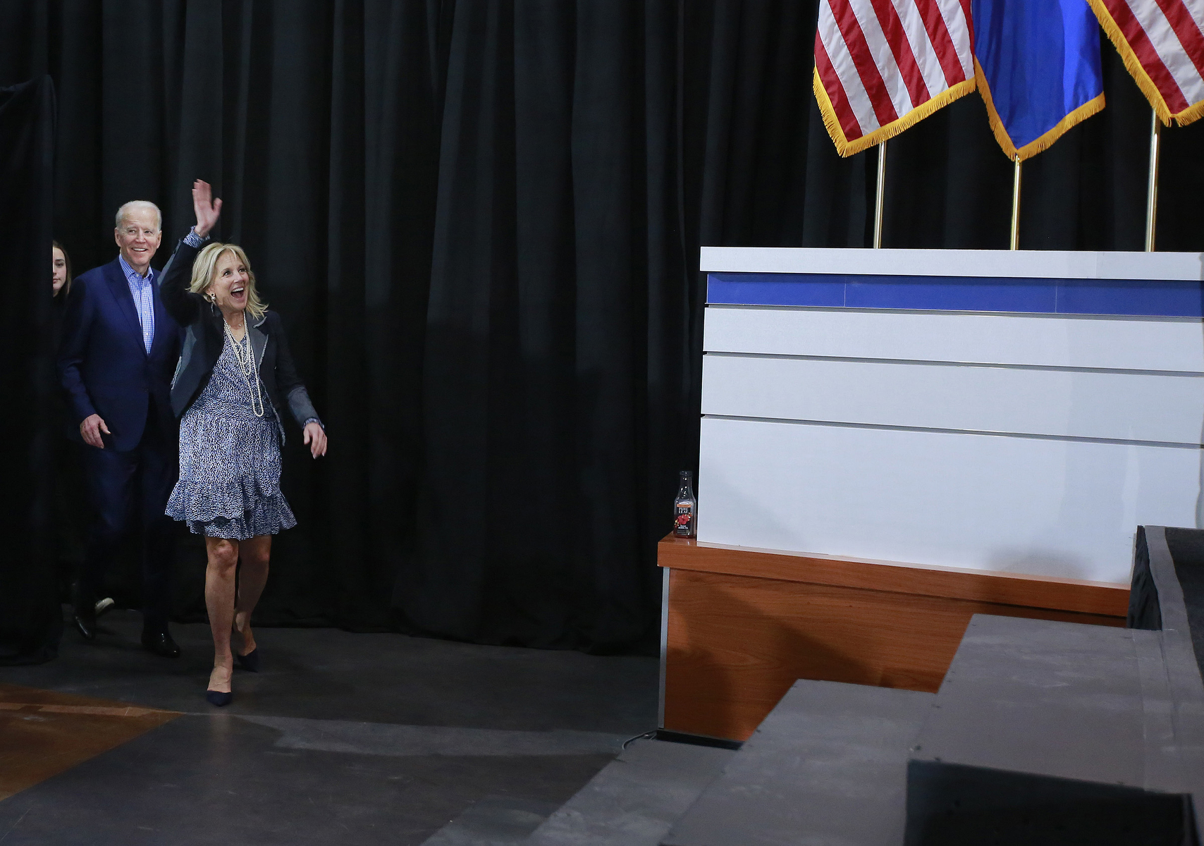 Democratic presidential candidate and former Vice President Joe Biden, left, enters with wife Jill during a Nevada Caucus watch party Saturday, Feb. 22, 2020, in Las Vegas. (Photo by Ronda Churchill/AFP)