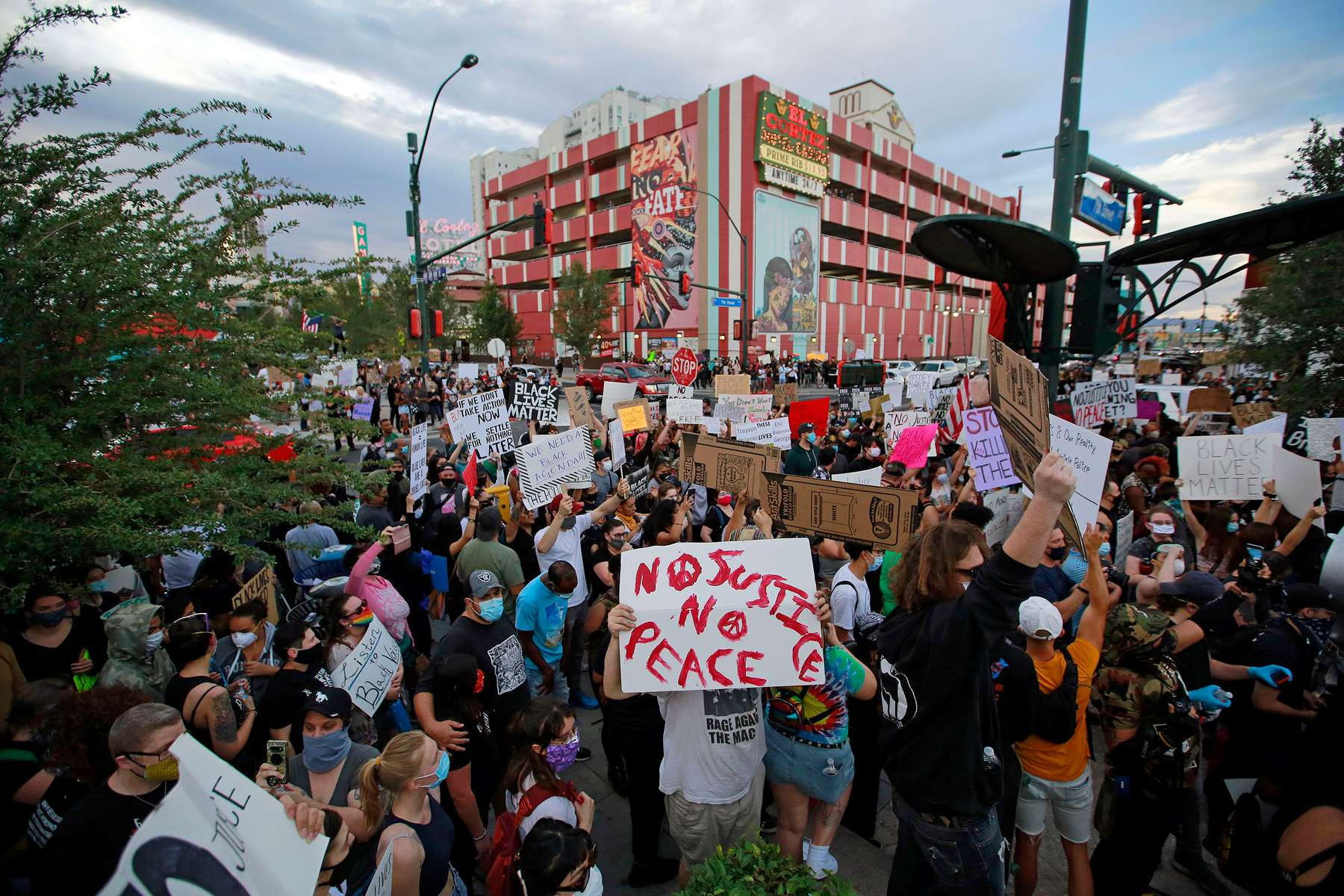 A crowd gathers for a Black Lives Matter protest Saturday, May 30, in downtown Las Vegas. The protest, which is one of many across the US this weekend, is in response to the recent death of Minneapolis man George Floyd, who died in police custody. (Ronda Churchill/ZUMA Press)