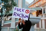 A woman holds a sign outside the Venetian hotel-casino during a Black Lives Matter protest along the Strip Monday, June 1, 2020, in Las Vegas. (Ronda Churchill/freelance)