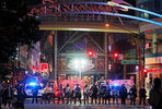 Police stand in formation at the entrance to Fremont Street Experience in downtown Las Vegas. Police were present for a community protest over the death of George Floyd, a Minneapolis man that died in police custody on Memorial Day. (Ronda Churchill/AP Photos)