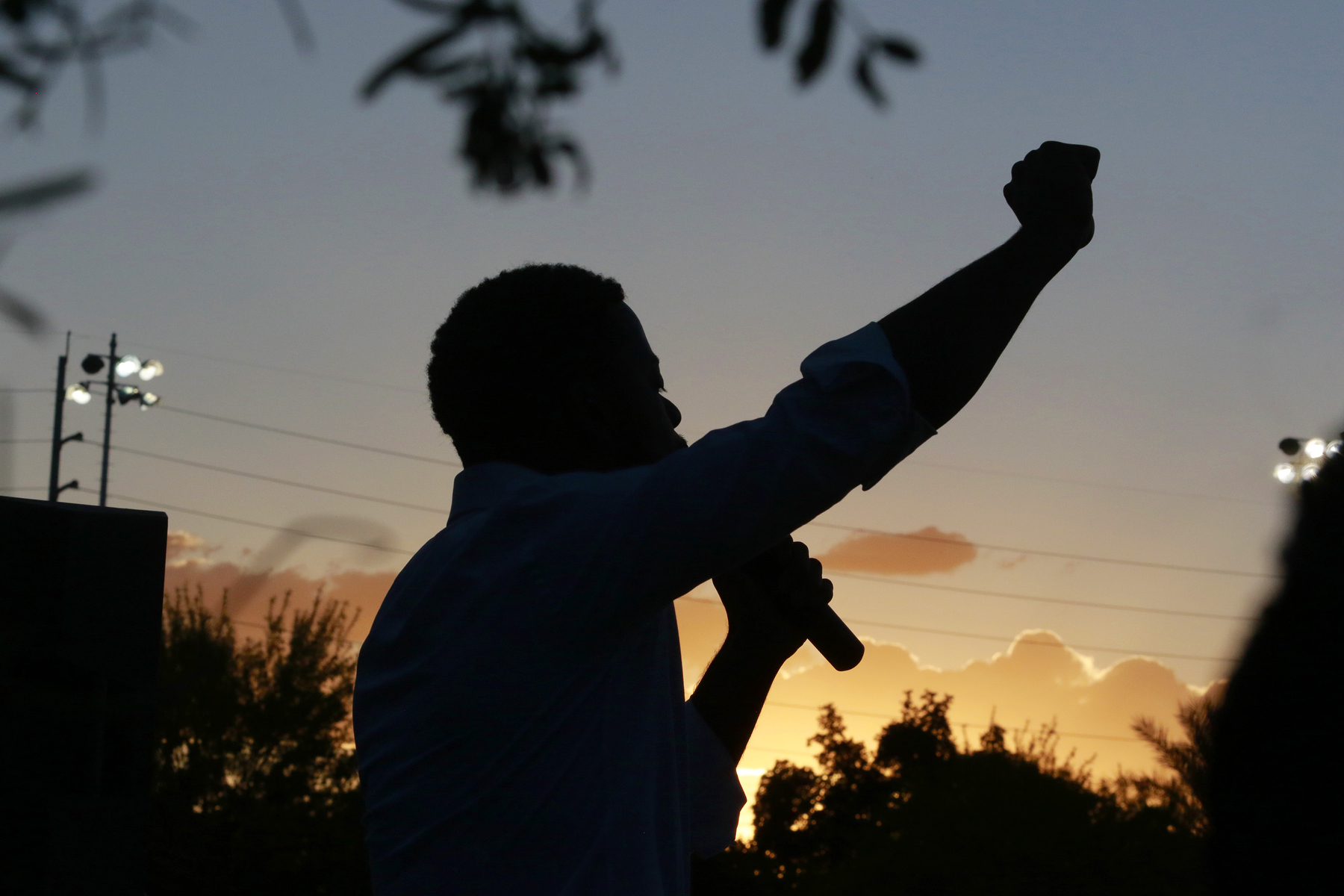 Assemblyman William McCurdy, D-Nev., is silhouetted while speaking at a rally in Las Vegas in response to the May 25 death of George Floyd, who died after being restrained by Minneapolis police.