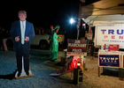 Pamela Morgan, dressed as Lady Liberty, and a President Trump cardboard cutout are shown near Bob Ruud Community Center on Election Day Tuesday, November 3, 2020, in Pahrump, Nevada. A tent of Trump supporters were set up within guidelines adjacent to the polling station.