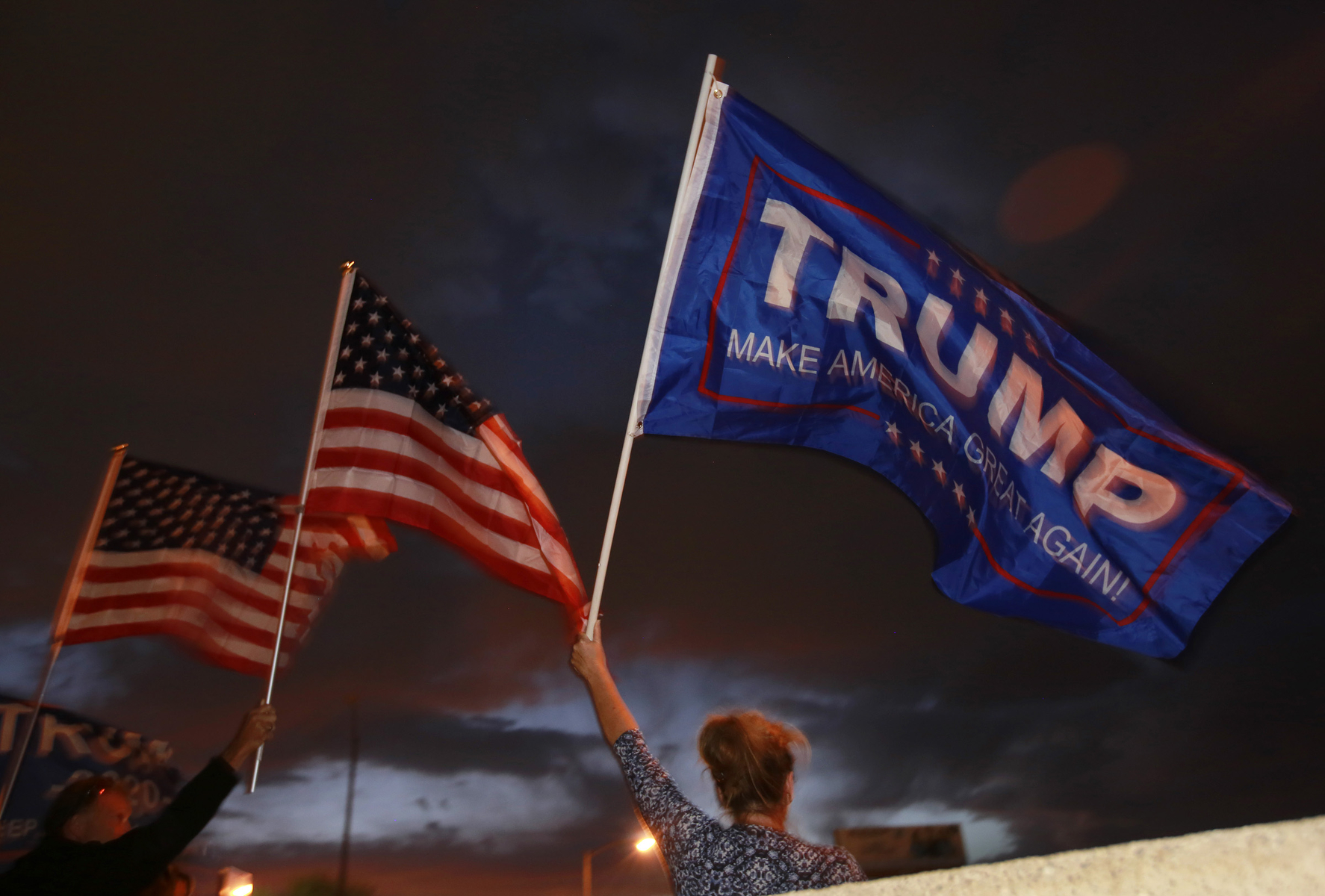 Donald Trump supporter and Las Vegas resident Maryann, last name withheld, holds a Trump flag and protests outside Clark County Election Department November 6, 2020, in North Las Vegas. (Photo by Ronda Churchill/AFP)