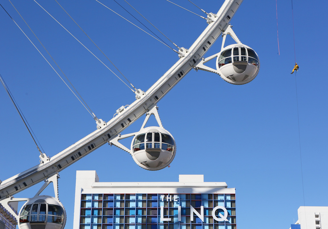A firefighter, top right, rappels from a pod (not pictured) on the High Roller at the Linq hotel-casino Wednesday, Feb. 24, 2016, in Las Vegas. Las Vegas Fire & Rescue and the Henderson Fire Department hosted a rescue training session at the world's tallest observation wheel
