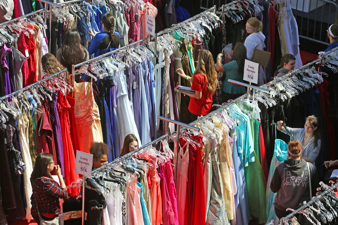 Teens and volunteers look through dresses during Project 150's 2016 Las Vegas Prom Closet event at Zappos Saturday, March 12, 2016, in Las Vegas. Local high school students were invited to shop for new and gently used prom dresses, tuxedos, shoes and accessories free of charge when presenting a student ID.