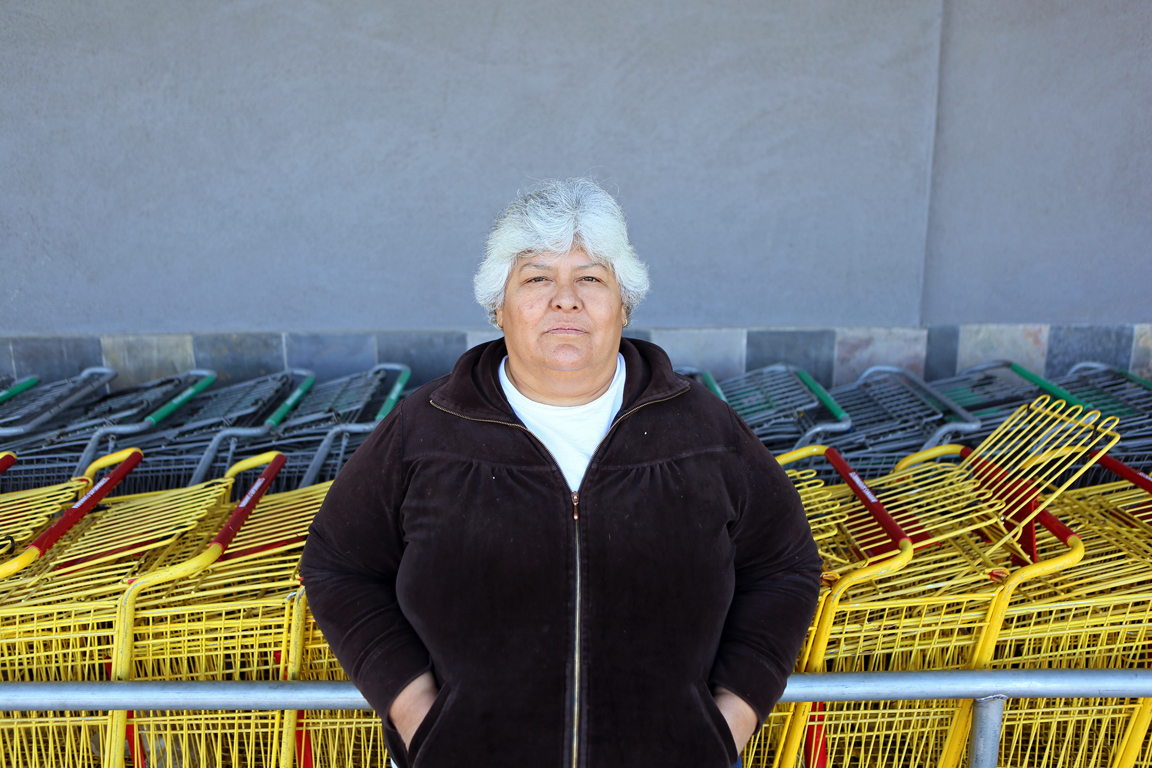 Maria Guadalupe Arreola, 50, stands outside Mariana's Supermarket Tuesday, Nov. 25, 2014, in Las Vegas. Arreola works a vendor booth in the market where she receives commission for selling land in a developing area in nearby Arizona and has struggled in the past financially where she almost lived homeless. Arreola, who was born in Jalisco, Mexico, has lived 25 years the United States as an undocumented immigrant.