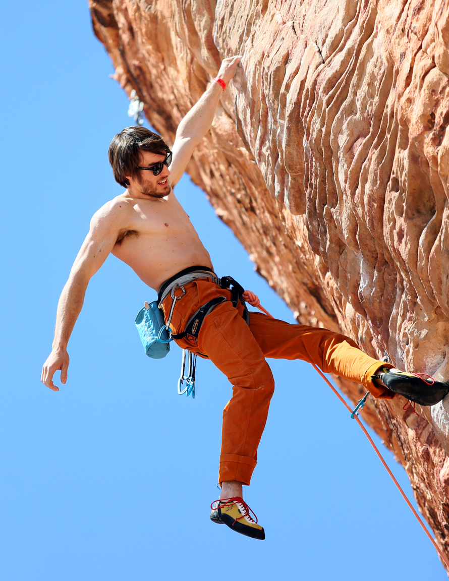 Professional rock climber Ethan Pringle, of San Francisco, lead climbs along the {quote}New Wave Hookers{quote} route at Calico Basin in Red Rock Canyon National Conservation Area Sunday, March 29, 2015, near Las Vegas. Athletes gathered at Red Rock and Spring Mountain Ranch State Park to participate in the weekend-long Red Rock Rendezvous, a rock climbing festival with clinics, outdoor activities and social events presented by Mountain Gear.