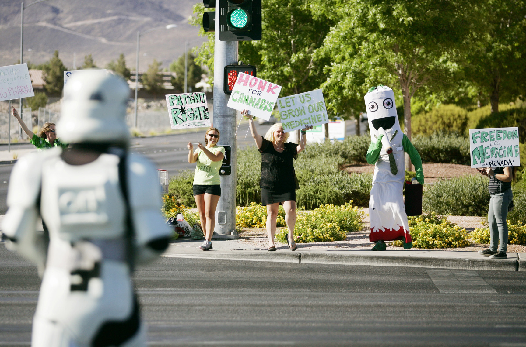 Members of the Cannabis Career Institute rally at the corner of Marks Street and West Warm Springs Road Saturday, June 1, 2013, in Henderson, Nev. The group walked to a nearby Hilton Grand Garden Inn, where The Cannabis Career Institute offered a class for starting your own medical marijuana dispensary.