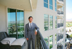 Randy Char, sr. vice president of sales and marketing at One Queensridge Place, stands on the balcony of a condominium at the Summerlin property located at 9103 Alta Dr. Tuesday, July 10, 2012, in Las Vegas.