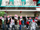 Members and supporters of the Culinary Local 266 union picket in front of Binion's hotel-casino and other areas along Fremont Street Experience Saturday, Oct. 13, 2012, in Las Vegas.